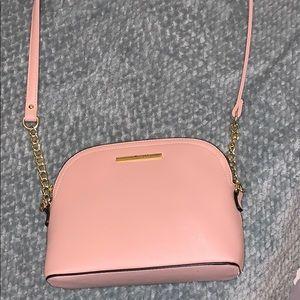 Lightly used pink Steve Madden crossbody bag